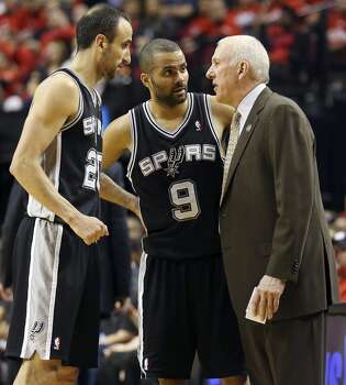 San Antonio Spurs' Manu Ginobili (left), and Tony Parker talks with head coach Gregg Popovich during second half action of Game 3 in the Western Conference semifinals against the Portland Trail Blazers Saturday May 10, 2014 at the Moda Center in Portland, OR. The Spurs won 118-103. Photo: Edward A. Ornelas, San Antonio Express-News