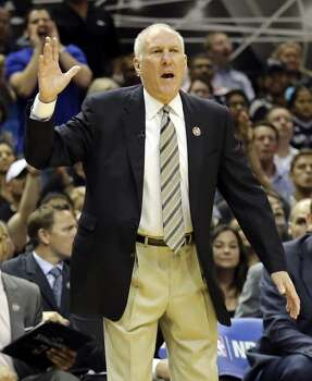 San Antonio Spurs head coach Gregg Popovich calls a play during first half action of Game 2 in the Western Conference semifinals against the Portland Trail Blazers Thursday May 8, 2014 at the AT&T Center. Photo: Edward A. Ornelas, San Antonio Express-News