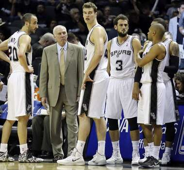 San Antonio Spurs head coach Gregg Popovich talks with the team during second half action of Game 1 in the first  round of the Western Conference playoffs against the Dallas Mavericks Sunday April 20, 2014 at the AT&T Center. The Spurs won 90-85. Photo: Edward A. Ornelas, San Antonio Express-News