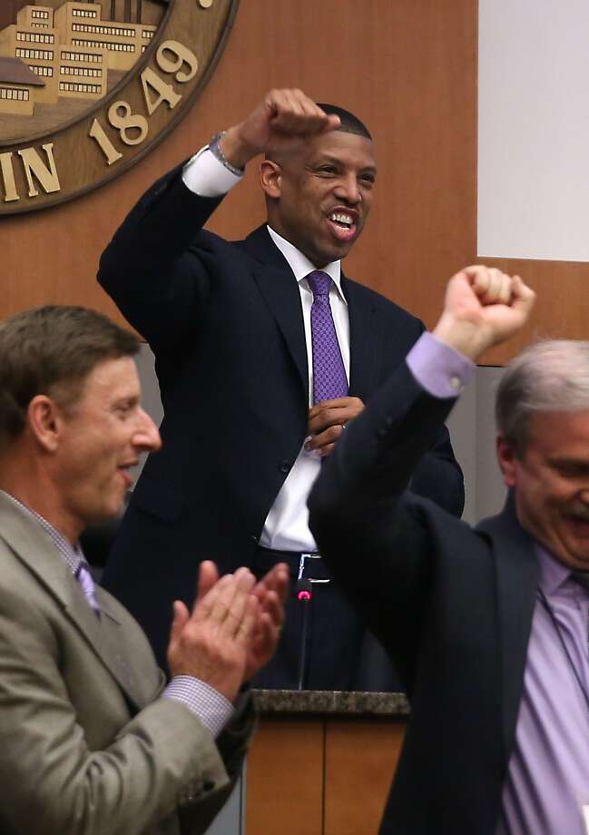 Sacramento Mayor Kevin Johnson pumps his fist after the City Council vote. Photo: Rich Pedroncelli, Associated Press