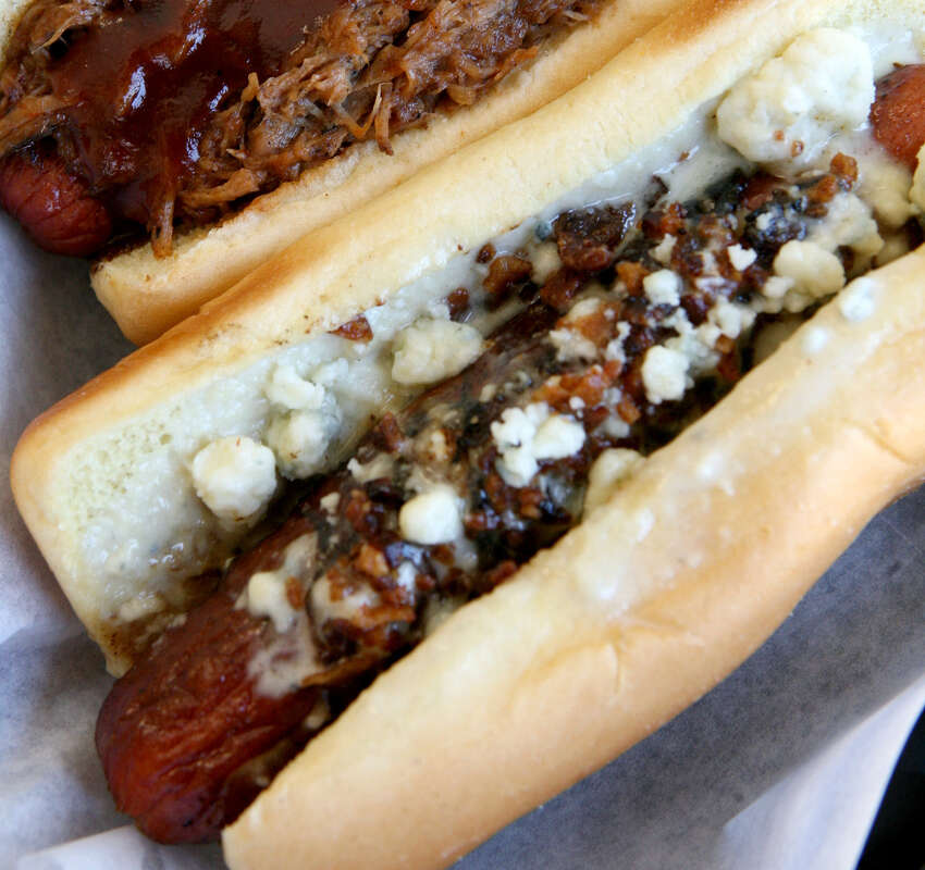 The pork dog (top) and the SA dog are served at the Original San Antonio Hot Dog House, which won Readers' Choice Best Hot Dog.