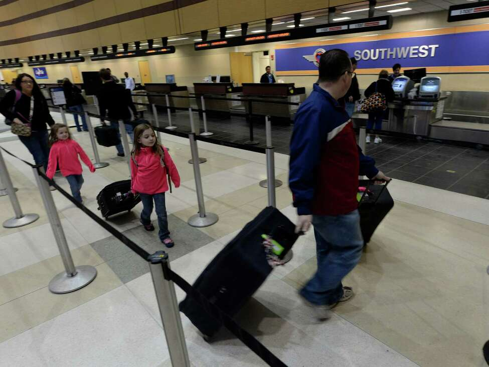A family queues up for a trip on Southwest Airlines Thursday morning Feb. 13, 2014 at the Albany International Airport in Colonie, N.Y. (Skip Dickstein / Times Union)