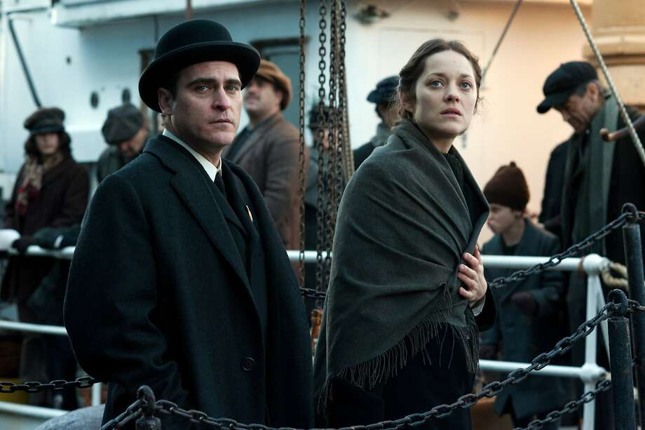 "Bruno (Joaquin Phoenix), who scouts Ellis Island regularly for ""talent,"" offers to help Polish immigrant Ewa (Marion Cotillard) in ""The Immigrant."" Photo: Anne Joyce, The Weinstein Company"