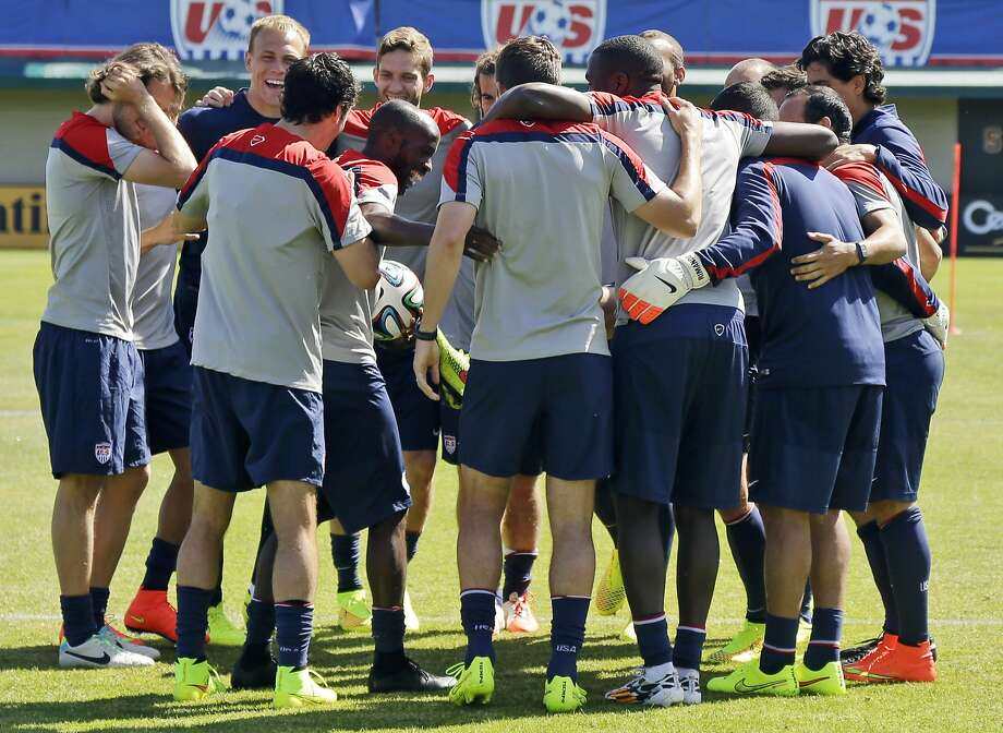 U.S. team members embrace at Stanford during training in preparation for the World Cup. Half the players vying to be on the final roster are from the MLS. Photo: Marcio Jose Sanchez, Associated Press