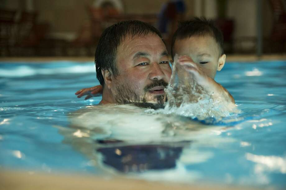 "Ai Weiwei and his son, Ai Lao, in the documentary ""Ai Weiwei: The Fake Case,"" which follows the dissident Chinese artist during the difficult days he endured after his release from jail. Photo: Andreas Johnsen, International Film Circuit"