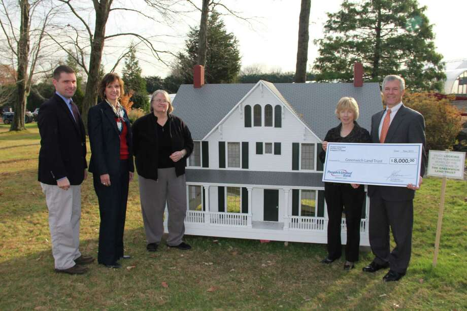 PeopleâÄôs United Bank has funded the design and construction of a 5-by-10 foot replica of the Louise Mueller Preserve farmhouse on Round Hill Road. From left to right, are David Jaeger, PeopleâÄôs United private banking group; Roberta Anderson, senior vice president of private banking; Jane D. Hogeman, president of Greenwich Land Trust board of directors; Virginia L. Gwynn, GLT executive director, and Micheal Keady, PeopleâÄôs United Greenwich regional banking market manager. Photo: Contributed Photo / Connecticut Post Contributed