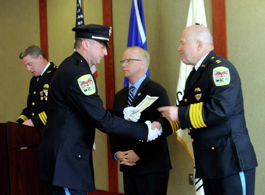 The Danbury Police Department holds its annual Memorial Day Service and Awards Ceremony, Wednesday, May 21, 2014, at police headquarters in Danbury, Conn. Photo: Carol Kaliff / The News-Times