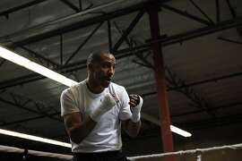 Super middleweight champion Andre Ward shadow boxes as he warms up for a training session at his private gym in Hayward, CA, Wednesday May 14, 2014.