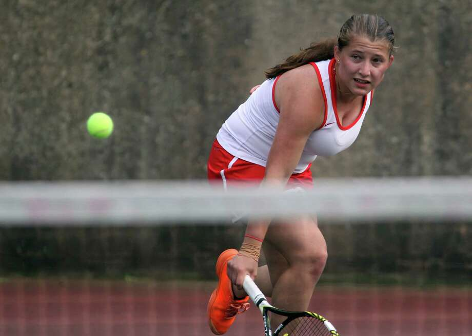 Anna Daccache returns a volley in her FCIAC quarter finals tennis match against Maddie Stow of Wilton in Greenwich, Conn. on Wednesday, May 21, 2014. Photo: J. Gregory Raymond / Stamford Advocate Freelance;  © J. Gregory Raymond