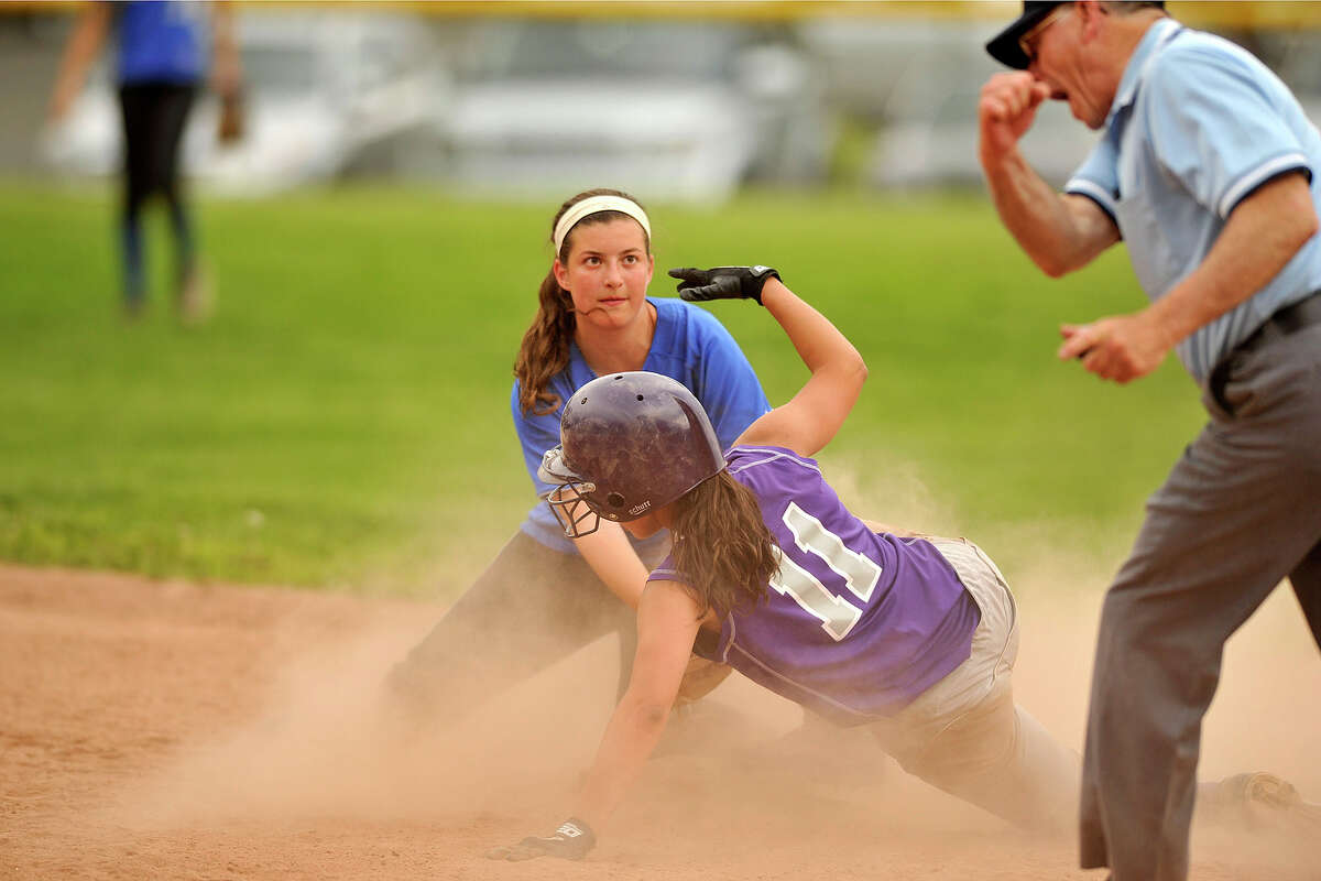 Darien shortstop Cassidy Schiff catches Westhill's Gabby Laccona trying to steal second base during their softball game at Westhill High School in Stamford, Conn., on Wednesday, May 21, 2014. Darien won, 6-0.