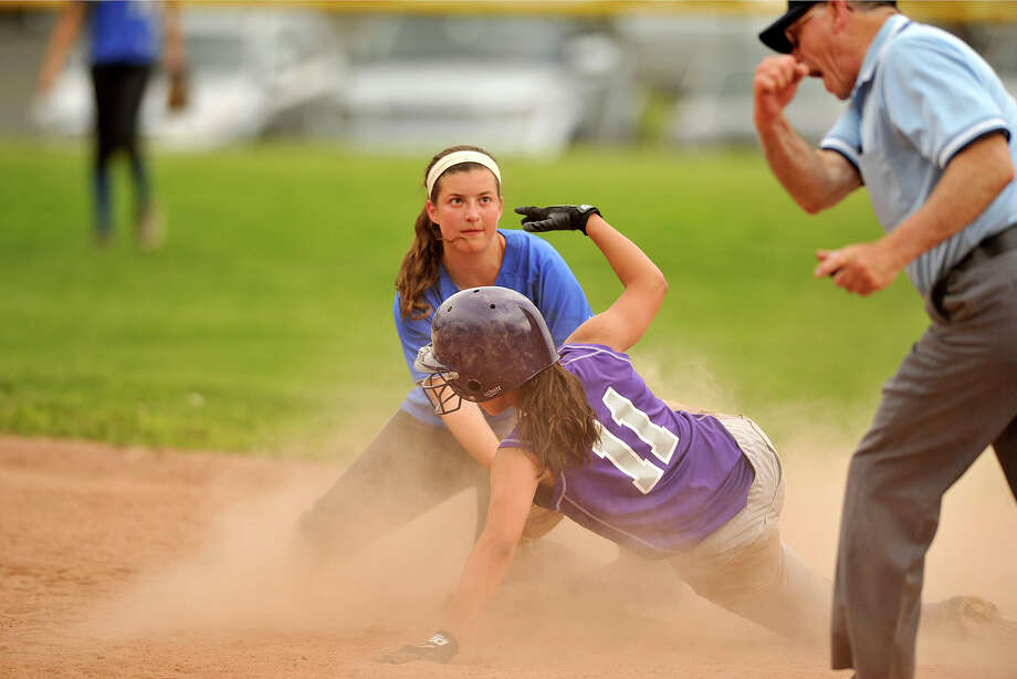 Darien shortstop Cassidy Schiff catches Westhill's Gabby Laccona trying to steal second base during their softball game at Westhill High School in Stamford, Conn., on Wednesday, May 21, 2014. Darien won, 6-0. Photo: Jason Rearick / Stamford Advocate