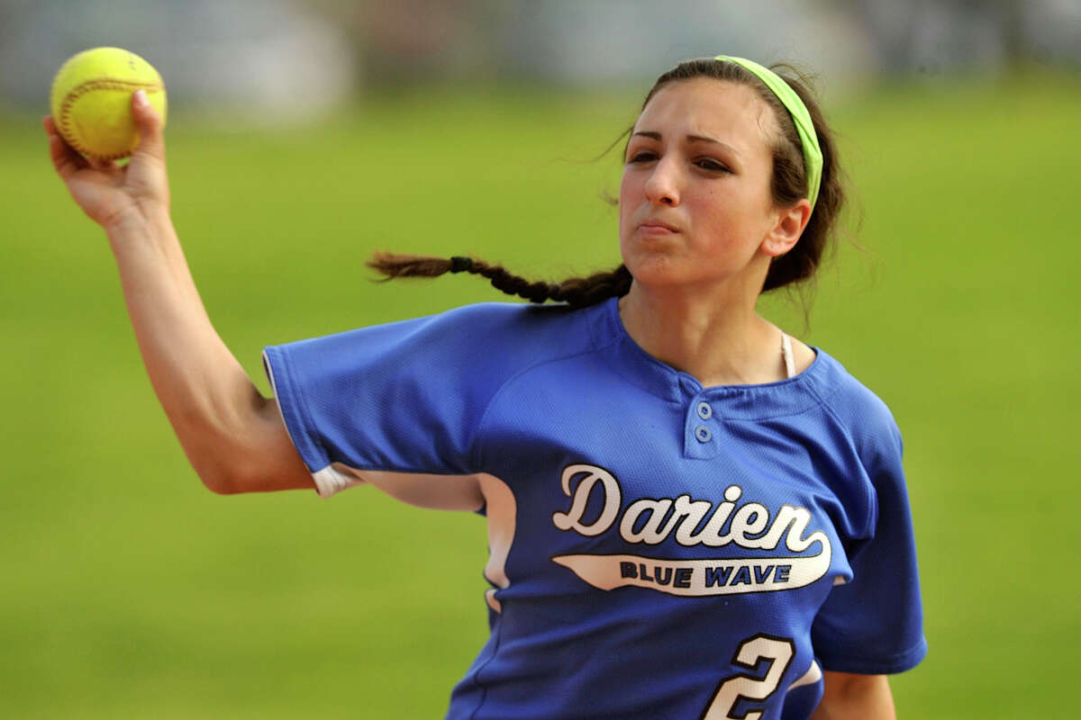 Darien second baseman Kelly Vodola fields the ball and fires to first during the Blue Wave's softball game against Westhill at Westhill High School in Stamford, Conn., on Wednesday, May 21, 2014. Darien won, 6-0.