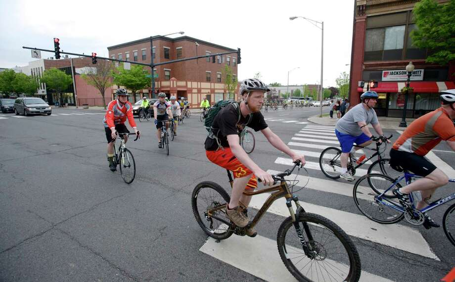 Bike riders turn onto Main Street from Liberty Street in downtown Danbury, Conn, during the Ride of Silence, on Wednesday evening, May 21, 2014. The Ride of Silence is an international bicycle ride to honor bike riders killed or injured while riding on public roads and is held the third Wednesday in May each year. Photo: H John Voorhees III / The News-Times Freelance