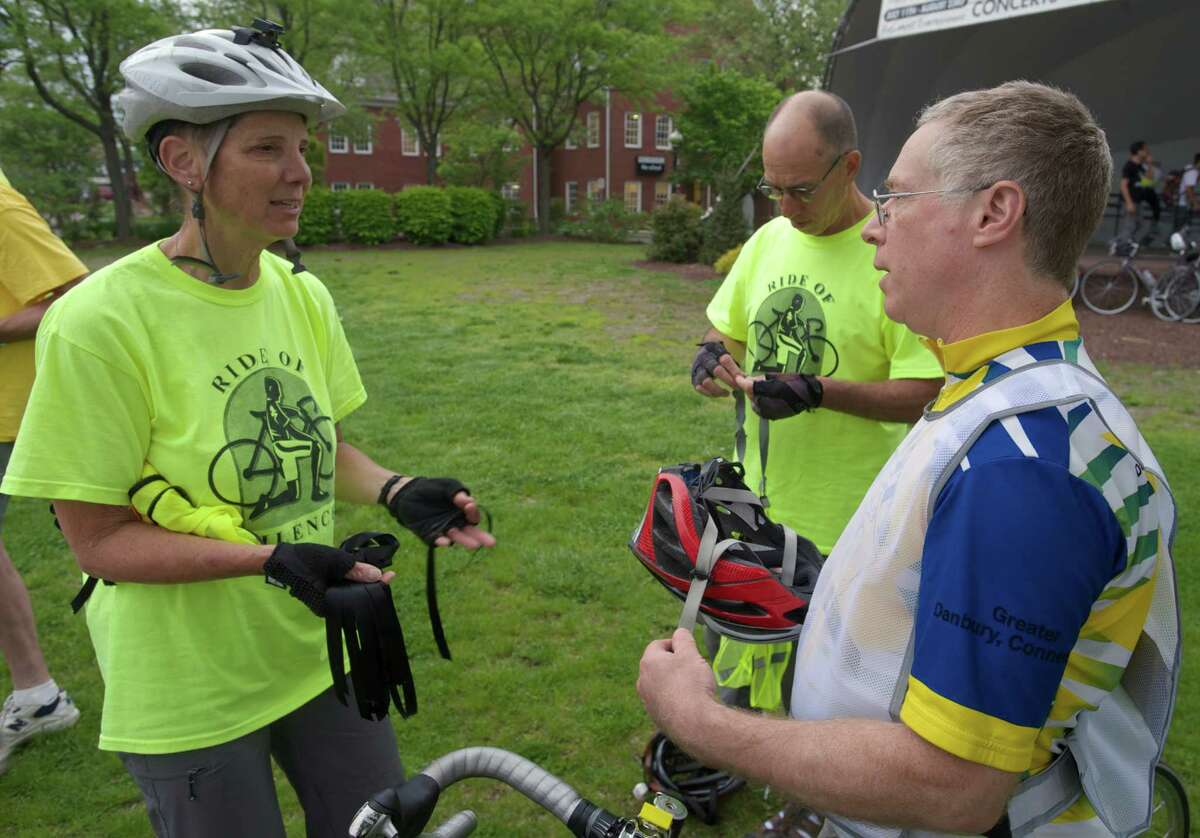 Marti Fine, 63, of Danbury, left, talks with Alan Stempel, 62, of Danbury, on the Danbury Green, before the start of the Ride of Silence, on Wednesday evening, May 21, 2014. Fine organized the ride in Danbury, Conn, this year. The Ride of Silence is an international bicycle ride to honor bike riders killed or injured while riding on public roads and is held the third Wednesday in May each year. Behind them is Dave Fine, 62, of Danbury.