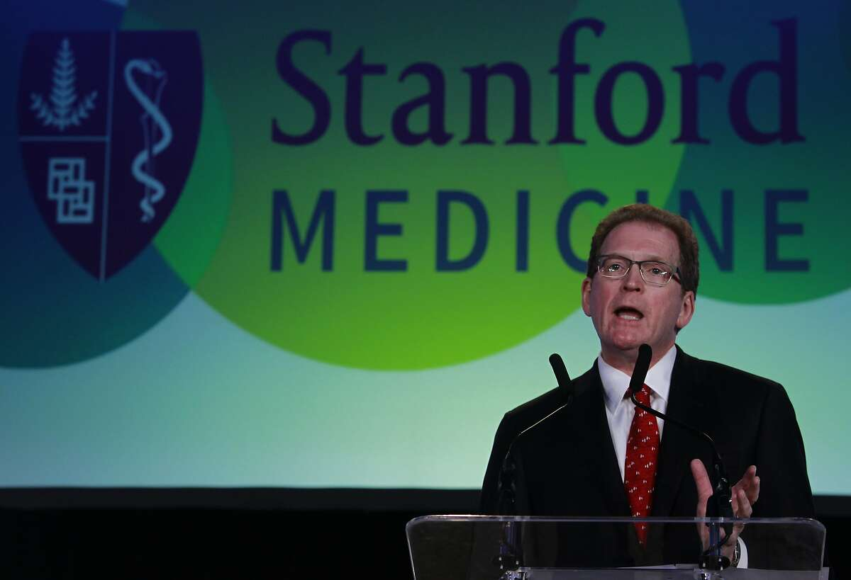 Lloyd Minor, dean of the Stanford University School of Medicine, greets attendees of the Big Data in Biomedicine conference in Stanford, Calif. on Wednesday, May 21, 2014.