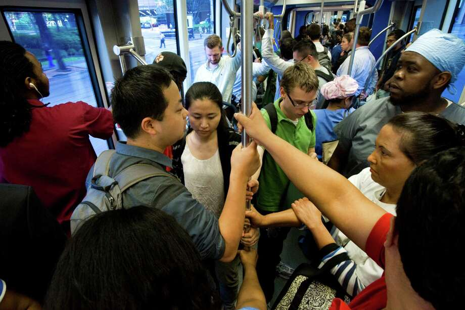 Passengers ride the MetroRail southbound, Wednesday, May 21, 2014, in Houston. ( Marie D. De Jesus / Houston Chronicle ) Photo: Marie D. De Jesus, Staff / © 2014 Houston Chronicle