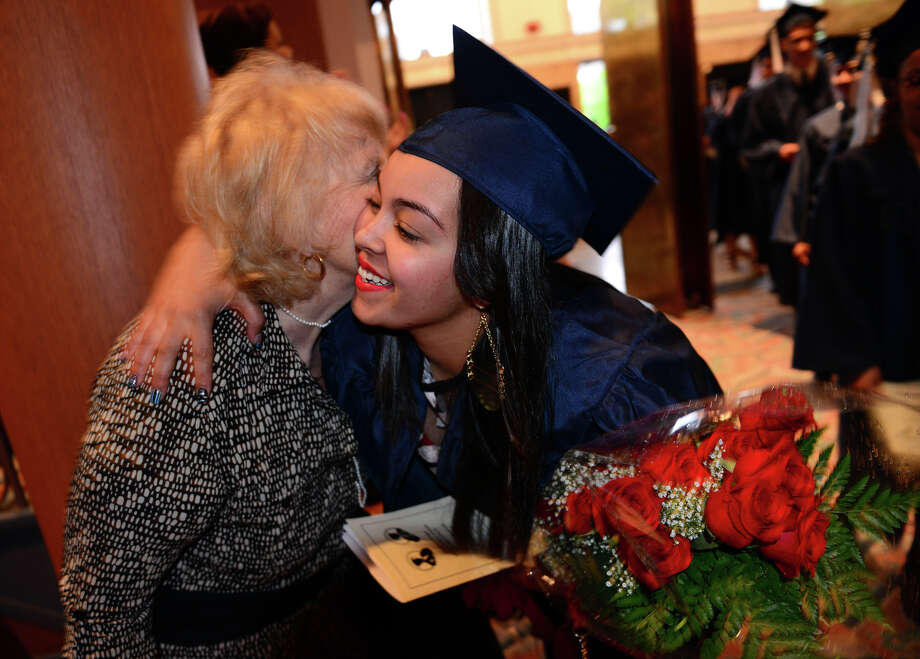 Graduate Samantha Reyes hugs her biology teacher Nancy Walsh at the start of Bridgeport Adult Education Graduation at the Klein Memorial Auditorium in Bridgeport, Conn. on Wednesday May 21, 2014. Photo: Christian Abraham / Connecticut Post