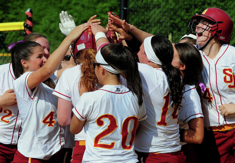 St. Joseph teammates surround Madeline Meier after she hit a two run homer, during softball action against Fairfield Ludlowe in Trumbull, Conn. on Wednesday May 21, 2014. Photo: Christian Abraham / Connecticut Post