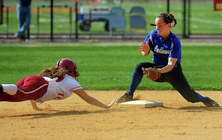 St. Joseph's Jenna Carrano attempts to make it back to second base as Fairfield Ludlowe's Alice Nelson prepares to tag her out, during softball action in Trumbull, Conn. on Wednesday May 21, 2014. Photo: Christian Abraham / Connecticut Post