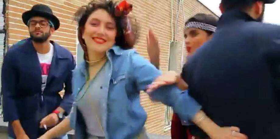 """In a YouTube video, people dance to Pharrell Williams' hit song """"Happy"""" on a rooftop in Tehran, Iran. Police arrested six young people for posting the video. Photo: Associated Press / AP"""