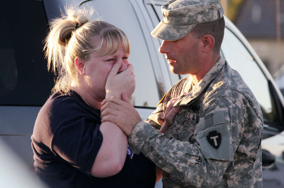 Sgt. Anthony Sills comforts his wife as they wait outside Fort Hood the day of the rampage in 2009. Photo: Associated Press / File Photo / FR59553 AP