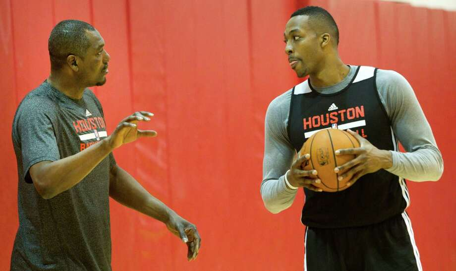 Former Houston Rockets center Hakeem Olajuwon, left, works with Dwight Howard during practice at Toyota Center Tuesday, April 29, 2014, in Houston. The Rockets, down 3-1 in the best-of-7 NBA Western Conference first round playoffs, face the Portland Trail Blazers in Game 5 on Wednedaty. ( Brett Coomer / Houston Chronicle ) Photo: Brett Coomer, Staff / © 2014 Houston Chronicle