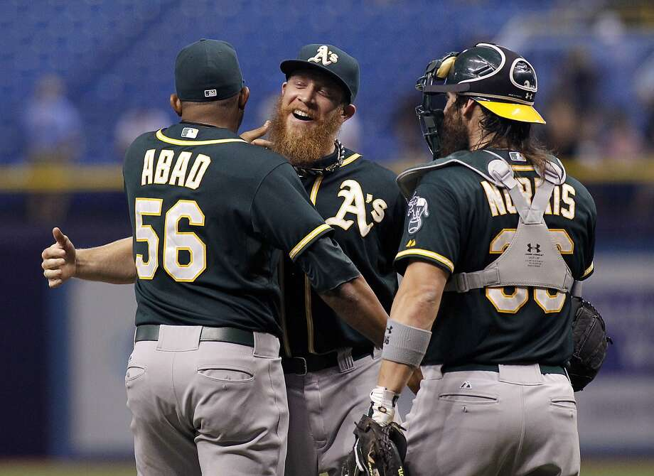 Sean Doolittle (second from left) earned his second save in two nights, allowing only a hit off the catwalk above the plate. Photo: Brian Blanco, Getty Images