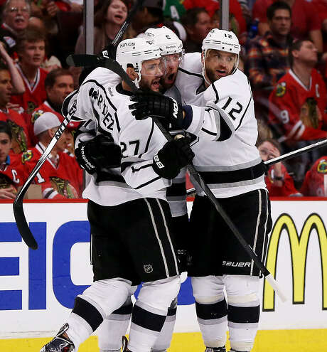 The Kings' Jake Muzzin (center) celebrates with teammates after scoring a third-period goal. Photo: Jonathan Daniel / Getty Images / 2014 Getty Images