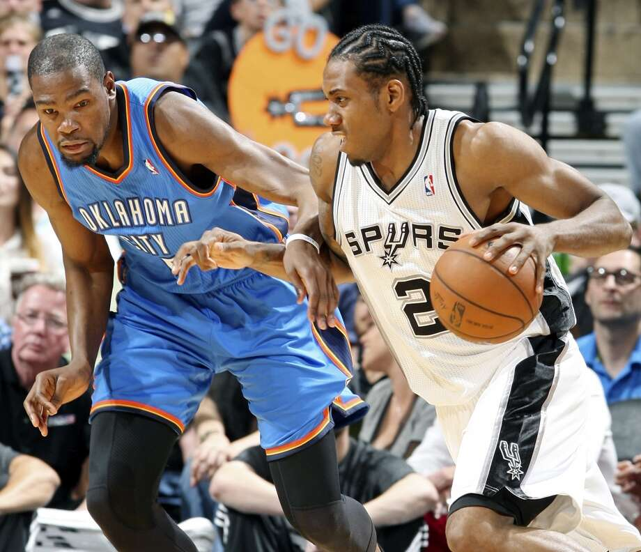 San Antonio Spurs' Kawhi Leonard looks for room around Oklahoma City Thunder's Kevin Durant during first half action of Game 2 in the Western Conference Finals Wednesday May 21, 2014 at the AT&T Center. (Edward A. Ornelas/Express-News) Photo: Edward A. Ornelas, San Antonio Express-News