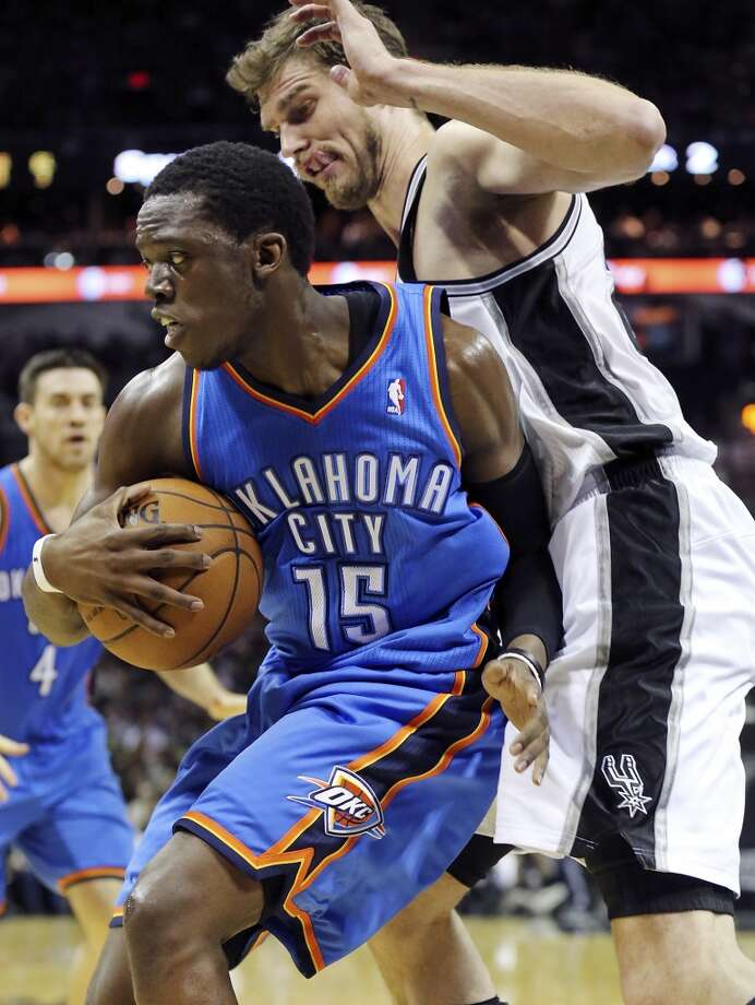 Oklahoma City Thunder's Reggie Jackson looks for room around San Antonio Spurs' Tiago Splitter during first half action of Game 2 in the Western Conference Finals Wednesday May 21, 2014 at the AT&T Center. (Edward A. Ornelas/Express-News) Photo: Edward A. Ornelas, San Antonio Express-News