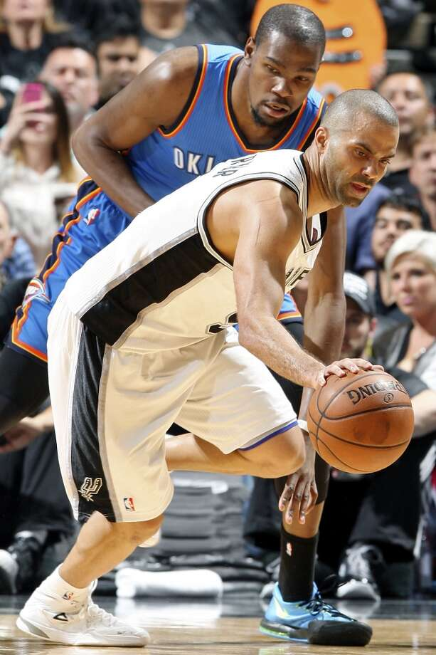 San Antonio Spurs' Tony Parker looks for room around Oklahoma City Thunder's Kevin Durant during first half action of Game 2 in the Western Conference Finals Wednesday May 21, 2014 at the AT&T Center. (Edward A. Ornelas/Express-News) Photo: Edward A. Ornelas, San Antonio Express-News