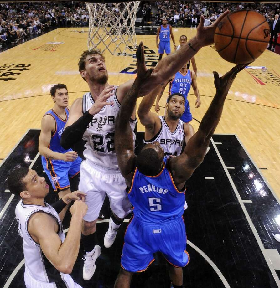 San Antonio Spurs' Tiago Splitter grabs for a rebound against Oklahoma City Thunder's Kendrick Perkins during first half action of Game 2 in the Western Conference Finals Wednesday May 21, 2014 at the AT&T Center. (Edward A. Ornelas/Express-News) Photo: Edward A. Ornelas, San Antonio Express-News
