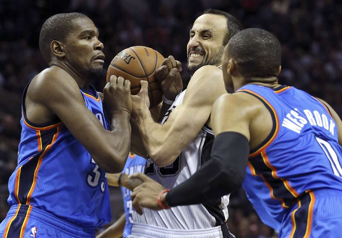 Manu Ginobili draws a foul on Kecin Durant as he squeezes into the lane against Russell Westbrook as the San Antonio Spurs play the Oklahoma City Thunder in game 2 of the Western Conference Finals at the AT&T Center on May 21, 2014. (Tom Reel/Express-News)