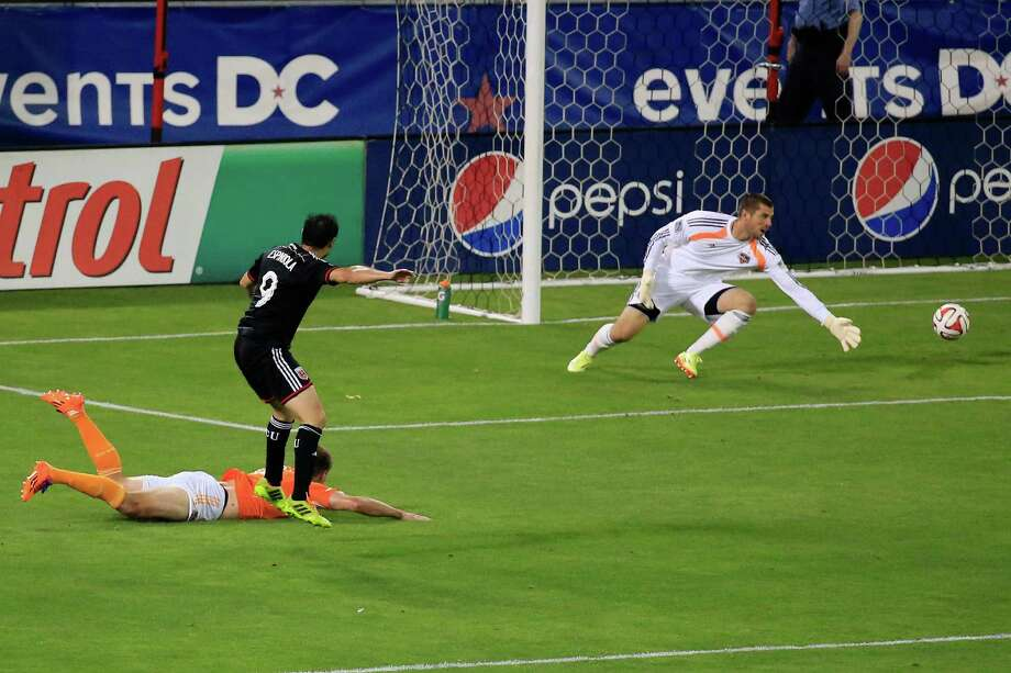 WASHINGTON, DC - MAY 21: Fabian Espindola #9 of D.C. United scores a second half goal on goalie Tally Hall #1 of Houston Dynamo at RFK Stadium on May 21, 2014 in Washington, DC. Photo: Rob Carr, Getty Images / 2014 Getty Images