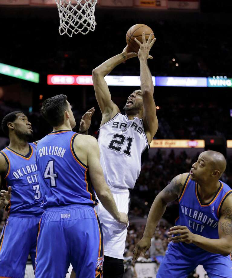 San Antonio Spurs' Tim Duncan (21) shoots over Oklahoma City Thunder's Perry Jones (3) and Nick Collison (4) during the first half of Game 2 of the Western Conference finals NBA basketball playoff series, Wednesday, May 21, 2014, in San Antonio. (AP Photo/Eric Gay) ORG XMIT: TXEG114 Photo: Eric Gay / AP
