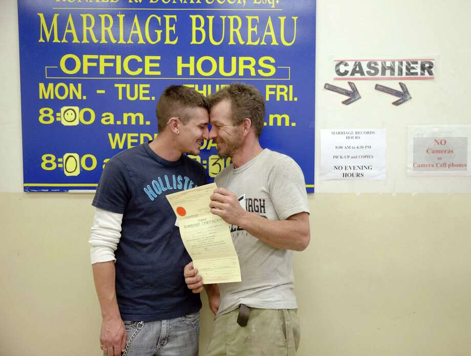 William Roletter (left) and Paul Rowe show their excitement after having a photo made with their newly acquired marriage certificate at City Hall in Philadelphia. Photo: Matt Rourke / Associated Press / AP
