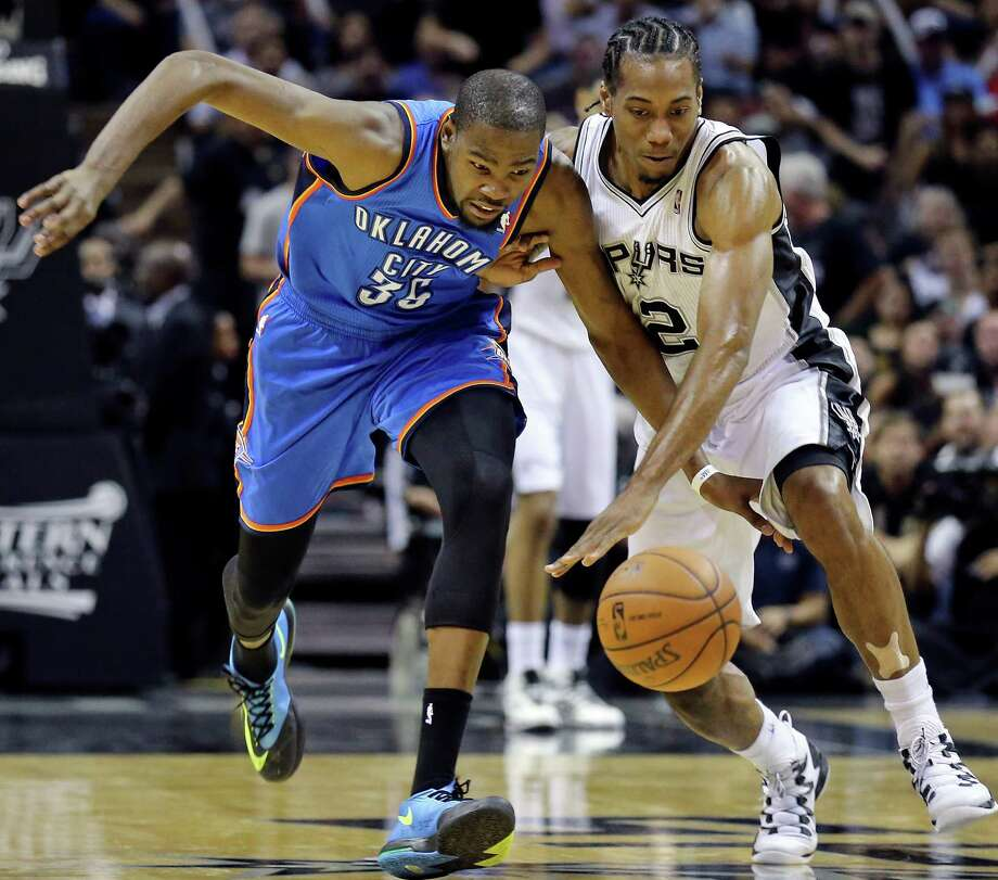 5ff3e542ac86 Oklahoma City Thunder s Kevin Durant and San Antonio Spurs  Kawhi Leonard  chase after a loose