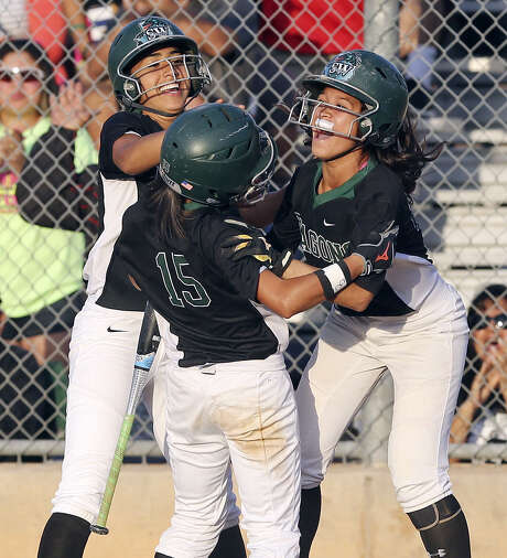 Amanda Sanchez (center), Yanira Fernandez (left), Kristal Salinas and the Southwest Dragons will be playing in a regional softball final for the first time tonight. Photo: Edward A. Ornelas / Express-News / © 2014 San Antonio Express-News