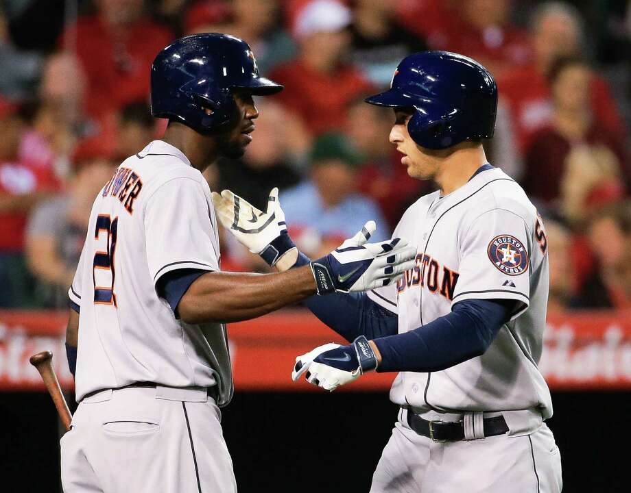 Astros right fielder George Springer, right, receives congratulations from Dexter Fowler for a fourth-inning homer that was Springer's fourth of the season. Photo: Chris Carlson, STF / AP