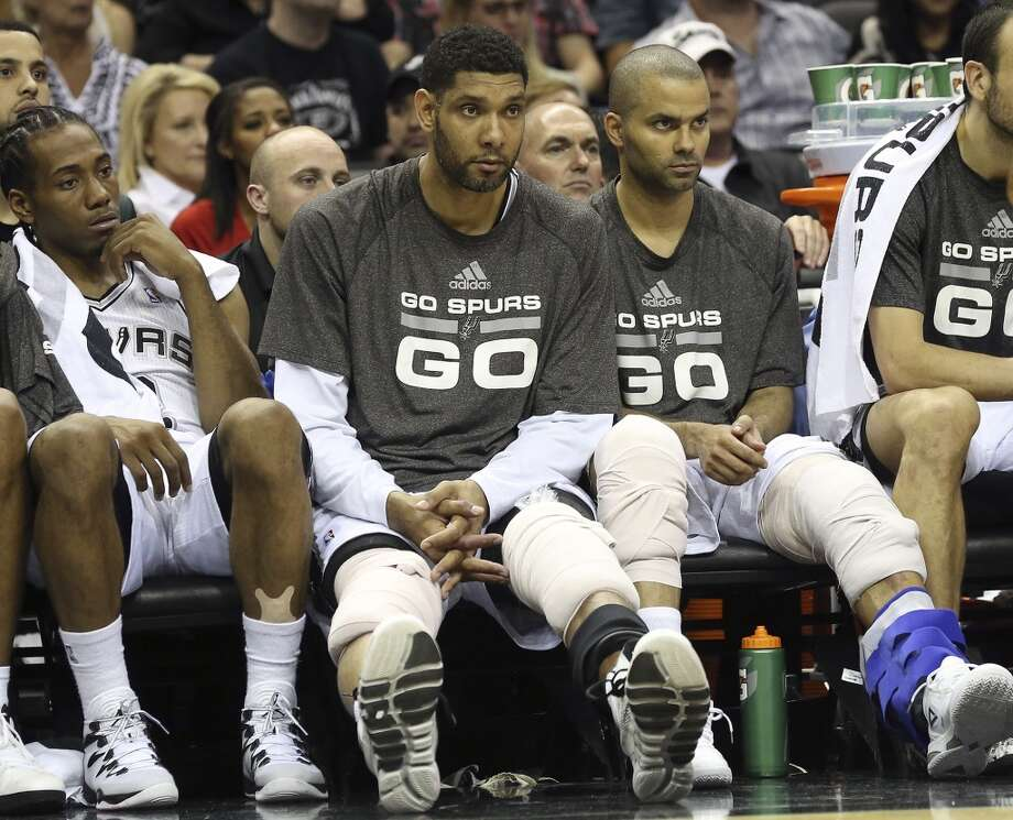 Tim Duncan and Tony Parker get an early ice down on the bench in the fourth quarter as the San Antonio Spurs play the Oklahoma City Thunder in game 2 of the Western Conference Finals at the AT&T Center on May 21, 2014. (Tom Reel/Express-News) Photo: TOM REEL