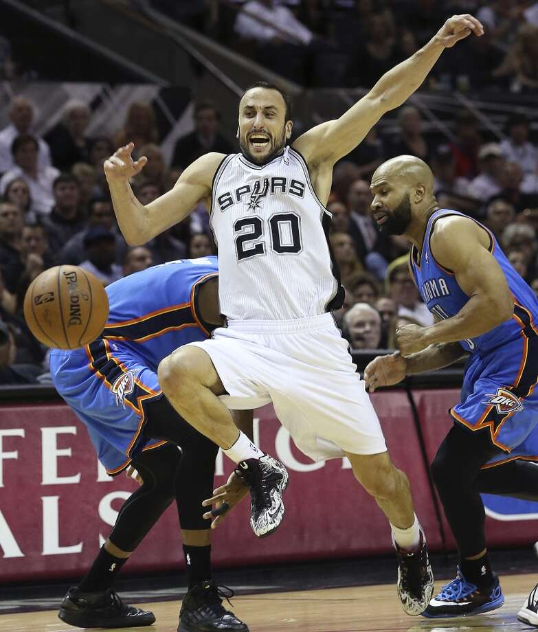 Manu Ginobili gets fouled trying to run through a trap as the San Antonio Spurs play the Oklahoma City Thunder in game 2 of the Western Conference Finals at the AT&T Center on May 21, 2014. (Tom Reel/Express-News) Photo: TOM REEL
