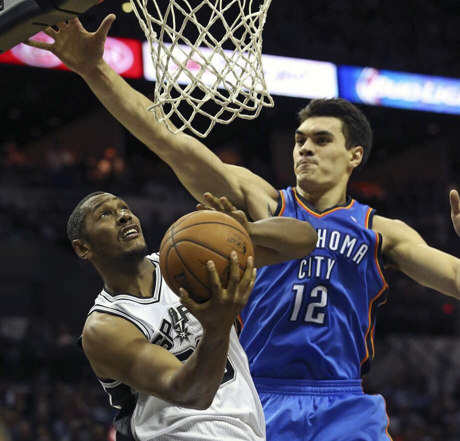 Boris Diaw gets a reverse layup on Steven Adams as the San Antonio Spurs play the Oklahoma City Thunder in game 2 of the Western Conference Finals at the AT&T Center on May 21, 2014. (Tom Reel/Express-News) Photo: TOM REEL