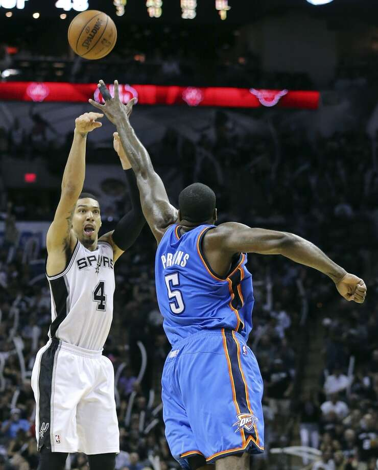 San Antonio Spurs' Danny Green shoots over Oklahoma City Thunder's Kendrick Perkins during second half action of Game 2 in the Western Conference Finals Wednesday May 21, 2014 at the AT&T Center. The Spurs won 112-77. (Edward A. Ornelas/Express-News) Photo: Edward A. Ornelas, San Antonio Express-News