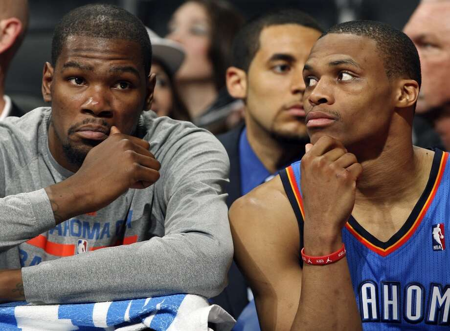Oklahoma City Thunder's Kevin Durant (left) and Russell Westbrook sit dejected on the bench late in Game 2 of the Western Conference Finals against the San Antonio Spurs Wednesday May 21, 2014 at the AT&T Center. The Spurs won 112-77. (Edward A. Ornelas/Express-News) Photo: Edward A. Ornelas, San Antonio Express-News