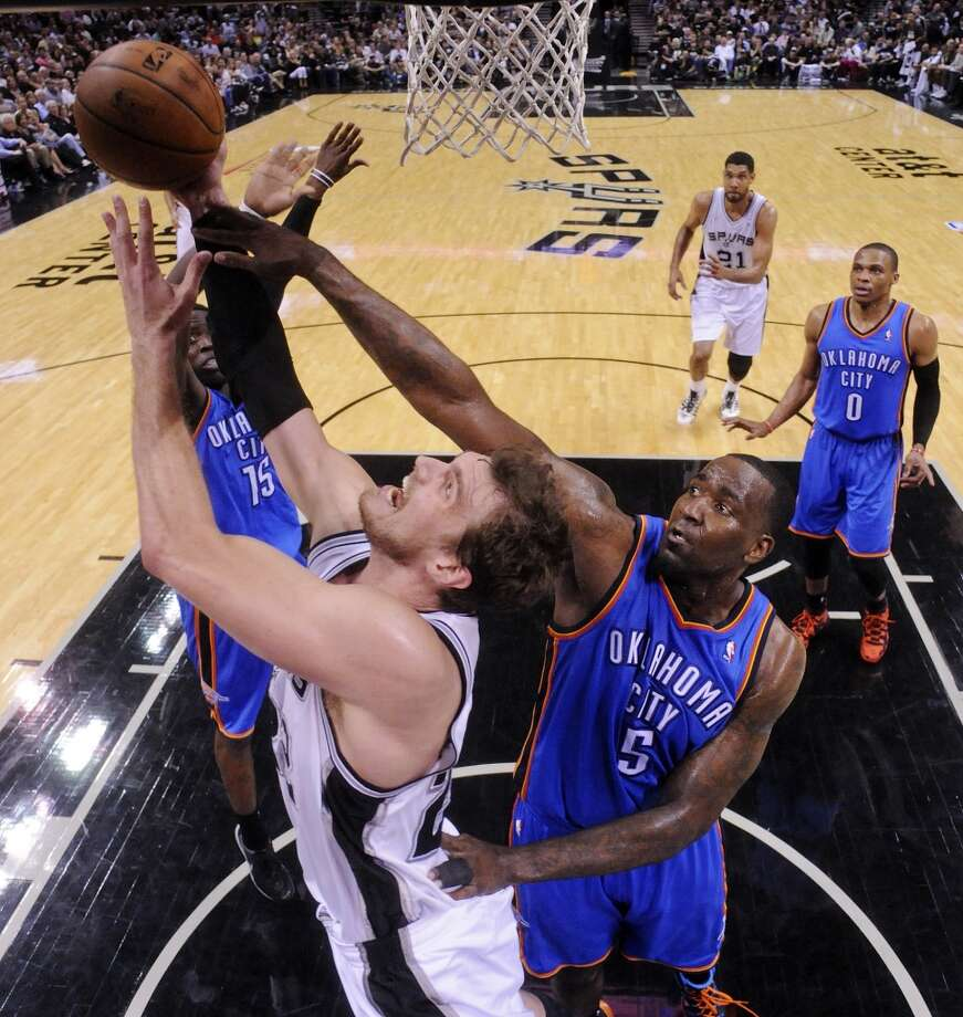 San Antonio Spurs' Tiago Splitter grabs for a rebound against Oklahoma City Thunder's Kendrick Perkins during second half action of Game 2 in the Western Conference Finals Wednesday May 21, 2014 at the AT&T Center. The Spurs won 112-77. (Edward A. Ornelas/Express-News) Photo: Edward A. Ornelas, San Antonio Express-News