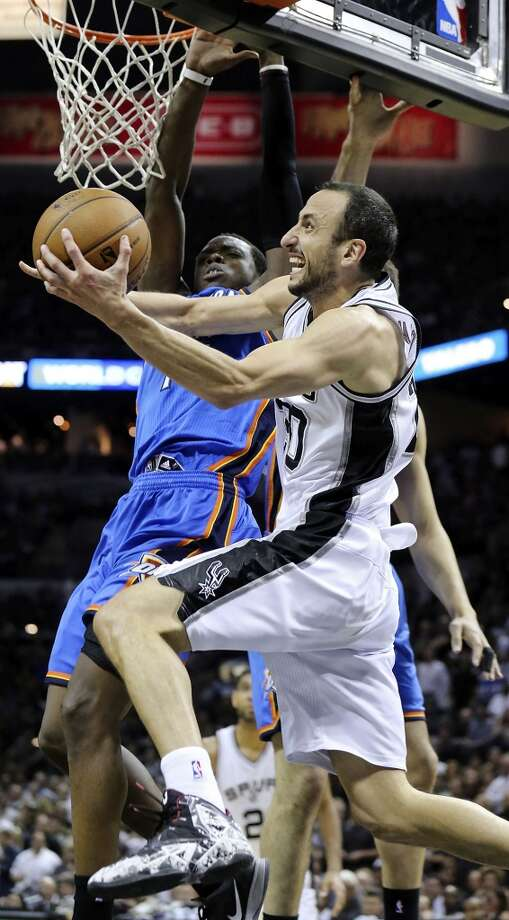 San Antonio Spurs' Manu Ginobili looks for room around Oklahoma City Thunder's Reggie Jackson during second half action of Game 2 in the Western Conference Finals Wednesday May 21, 2014 at the AT&T Center. The Spurs won 112-77. (Edward A. Ornelas/Express-News) Photo: Edward A. Ornelas, San Antonio Express-News