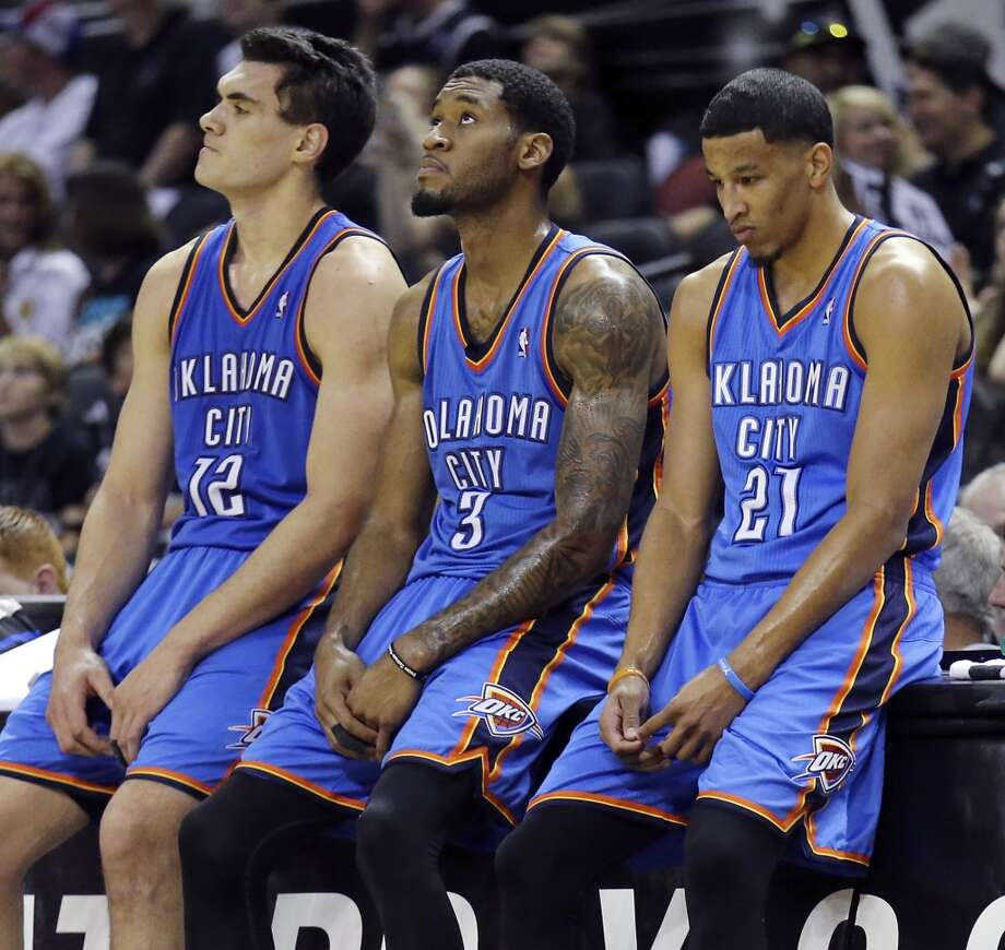 Oklahoma City Thunder's Steven Adams (from left) Perry Jones, and Andre Roberson wait to enter the game during second half action of Game 2 in the Western Conference Finals against the San Antonio Spurs Wednesday May 21, 2014 at the AT&T Center. The Spurs won 112-77. (Edward A. Ornelas/Express-News) Photo: Edward A. Ornelas, San Antonio Express-News
