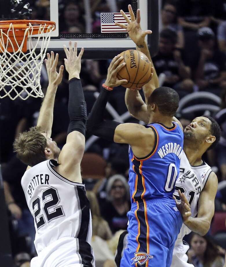 San Antonio Spurs' Tiago Splitter (left) and Tim Duncan defend Oklahoma City Thunder's Russell Westbrook during second half action of Game 2 in the Western Conference Finals Wednesday May 21, 2014 at the AT&T Center. The Spurs won 112-77. (Edward A. Ornelas/Express-News) Photo: Edward A. Ornelas, San Antonio Express-News