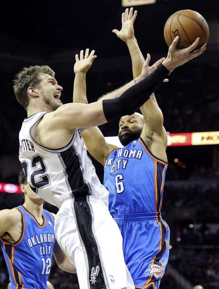 San Antonio Spurs' Tiago Splitter shoots around Oklahoma City Thunder's Derek Fisher during second half action of Game 2 in the Western Conference Finals Wednesday May 21, 2014 at the AT&T Center. The Spurs won 112-77. (Edward A. Ornelas/Express-News) Photo: Edward A. Ornelas, San Antonio Express-News