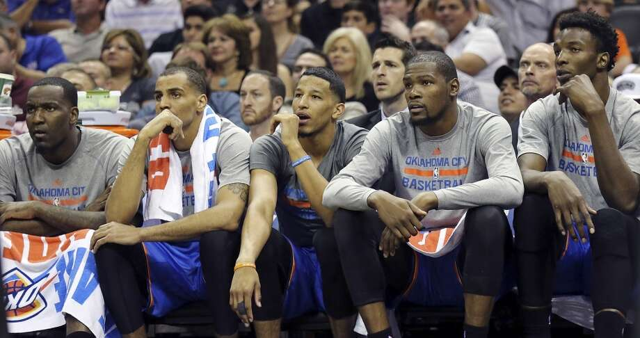 Members of the Oklahoma City Thunder watch second half action of Game 2 in the Western Conference Finals against the San Antonio Spurs from the bench Wednesday May 21, 2014 at the AT&T Center. The Spurs won 112-77. (Edward A. Ornelas/Express-News) Photo: Edward A. Ornelas, San Antonio Express-News